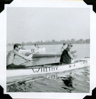 Young Scouts in a canoe that says Whitby on the side.