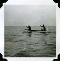 Two scouts in one canoe paddling on Lake Ontario.