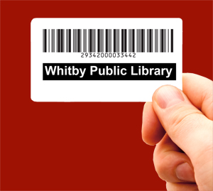 Image of hand holding a Whitby Public Library card.